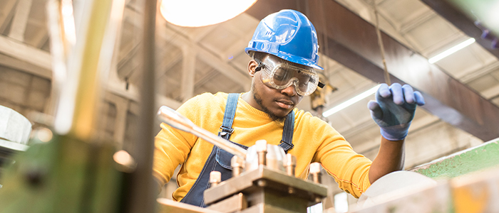 Factory worker adjusting for ergonomic solutions